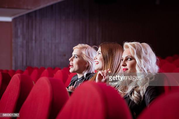 Three young women in the cinema
