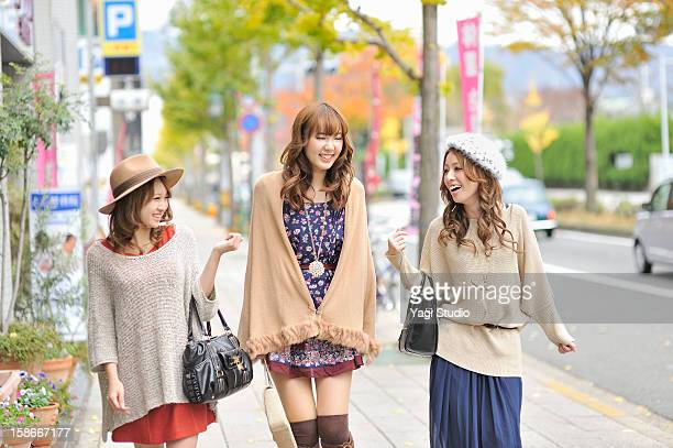 Three young women in the city,Smiling