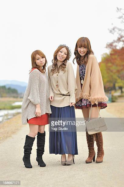 three young women in the park,smiling - in the park day 3 imagens e fotografias de stock