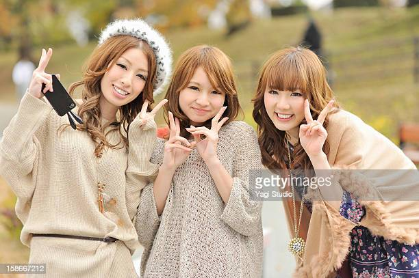 Three young women in the park,Smiling