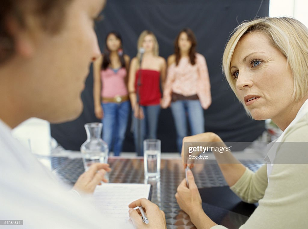 Three young women performing at an audition : Stock Photo