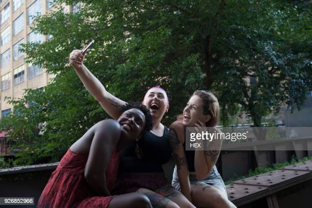 three young women posing for a selfie - short hair for fat women stock pictures, royalty-free photos & images