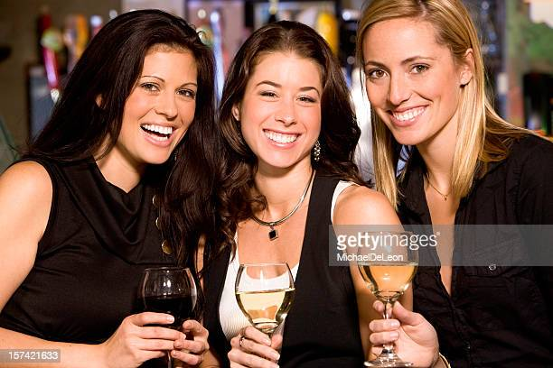 Three young women smiling on their night out