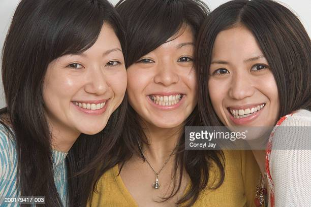 three young women, smiling, portrait, close-up - coneyl stock pictures, royalty-free photos & images