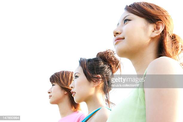 Three young women standing