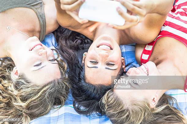 three young women taking selfie with smart phone - 69 position stock photos and pictures