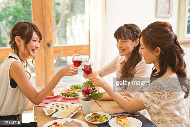 Three Young Women Toasting with Wine