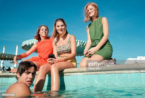 Three young women watch The Monkees' Davy Jones take a swim at a Dallas motel