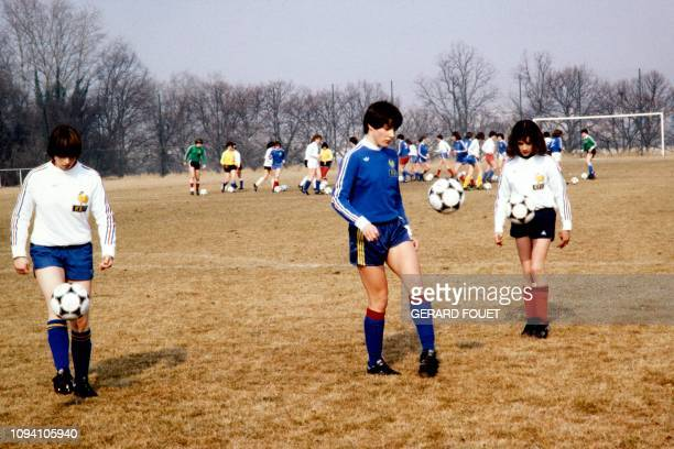 Three young women's football players juggle with the ball during a trainning session at the CREPS stadium in AixenProvence on February 18 1981 Sophie...