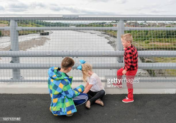 Three youngsters look out over the River Wear from the new Northern Spire bridge spanning the River Wear as it opens for a pedestrian walkover on...