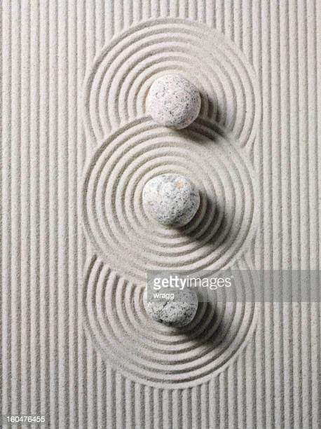 three zen stones and circles - sand stock pictures, royalty-free photos & images