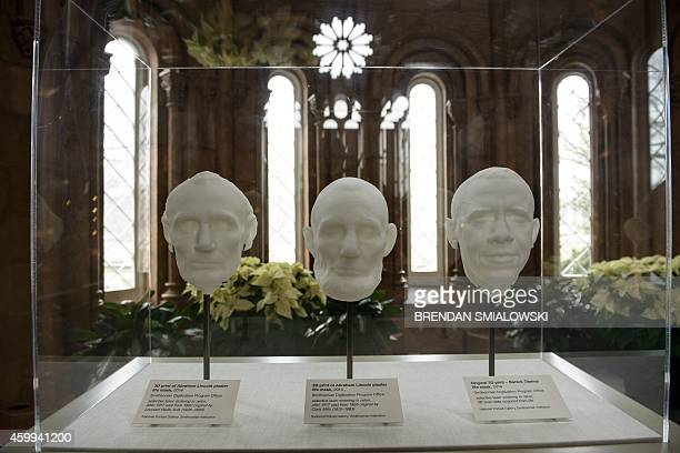 ThreeD prints of a 3D scan of former President Abraham Lincoln's life masks are seen with a print of a live 3D scan of US President Barack Obama at...