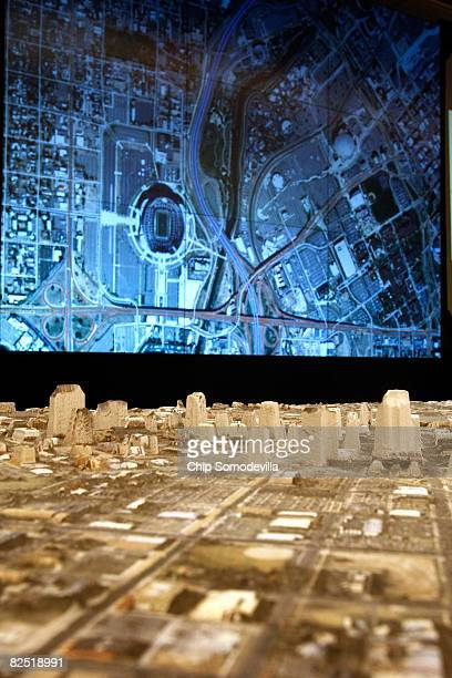 A threedimentional tabletop map stands before an eightfoot by eightfoot video screen displaying a map of downtown Denver during a news media tour of...