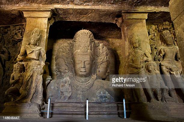 Three-faced statue of Lord Shiva in main  rock-cut temple on Elephanta Island in Mumbai Harbour.