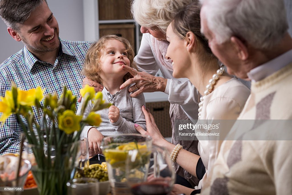 Three-generation family enjoying dinner : Stock Photo