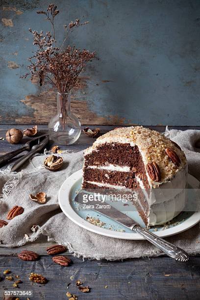 three-layer carrot cake with cream cheese frosting - carrot cake stock pictures, royalty-free photos & images