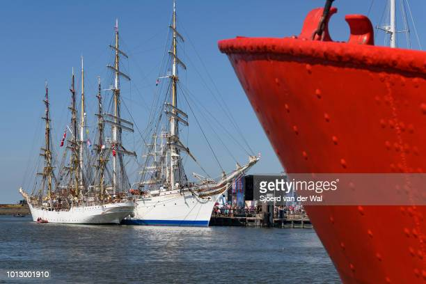 Threemasted barque rigged sail training vessel Statsraad Lehmkuhl and full rigged heritage ship Sørlandet from Norway moored the port of Harlingen...