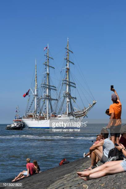 Threemasted barque rigged sail training vessel Statsraad Lehmkuhl from Norway entering the port of Harlingen during the finish of the 2018 Tall Ship...