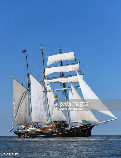 Three-masted topsail schooner Gulden Leeuw entering the port of Harlingen during the finish of the 2018 Tall Ship Race on August 3, 2018 in...