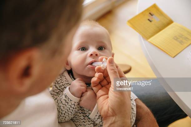 Three-month-old baby receiving oral vaccination