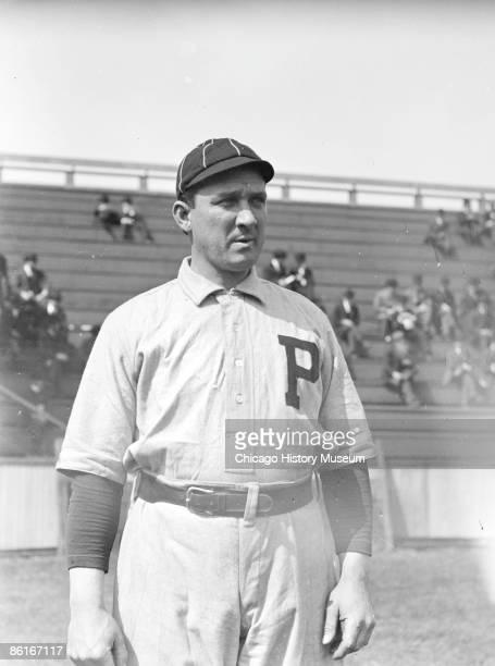 Three-quarter length portrait of baseball player, Bill Hallman, outfielder for the Philadelphia Phillies, National League, standing near bleachers at...