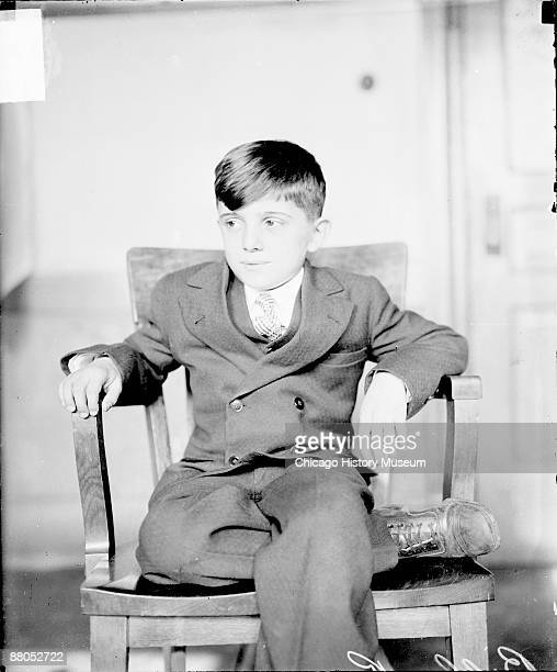 Threequarter length portrait of Billy Ranieri involved in the Ranieri case looking to his right sitting in a room in Chicago Illinois 1928 The boy...