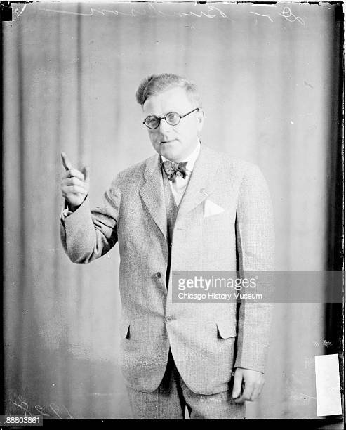 Threequarter length portrait of Dr Herman N Bundesen Cook County Coroner pointing with his right index finger and looking to his right standing in...
