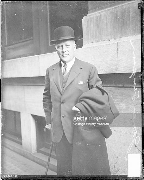 Threequarter length portrait of James Simpson head of Marshall Field Company looking toward the camera standing in front of a building in Chicago...