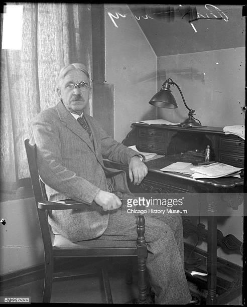 Threequarter length portrait of John Dewey professor at the University of Chicago philosopher and leader of the progressive movement looking toward...
