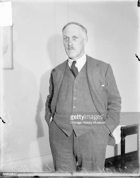 Threequarter length portrait of Major A Radcliffe Dugmore looking toward the camera standing in a room in Chicago Illinois 1928