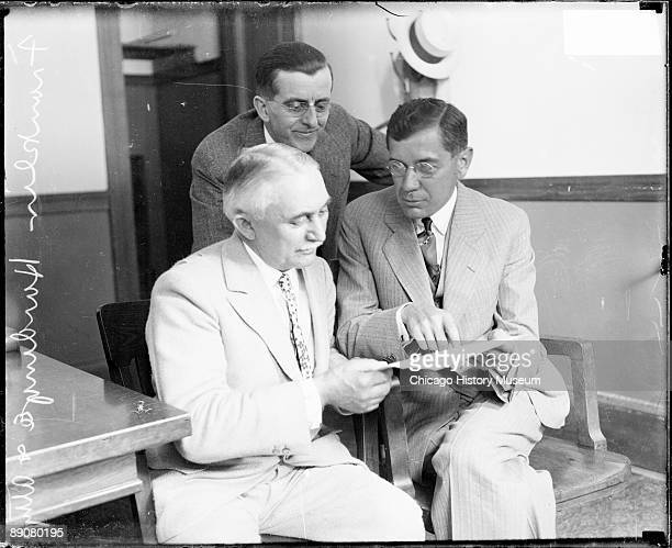 Three-quarter length portrait of millionaire Franklin Hardinge, sued in a a breach of promise case with Ann Livingston, sitting with his attorney and...