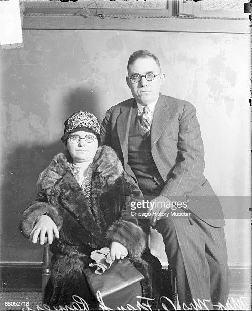 Threequarter length portrait of Mr and Mrs A Frank Ranieri looking toward the camera sitting in a room in Chicago Illinois 1928 Mrs Ranieri is...
