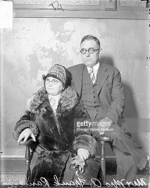 Threequarter length portrait of Mr and Mrs A Frank Ranieri looking to their right sitting in a room in Chicago Illinois 1928 Mrs Ranieri is sitting...