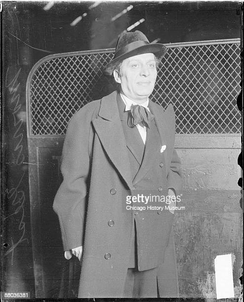Three-quarter length portrait of theater producer Morris Gest looking to the right of the camera, standing in a railroad station in Chicago,...