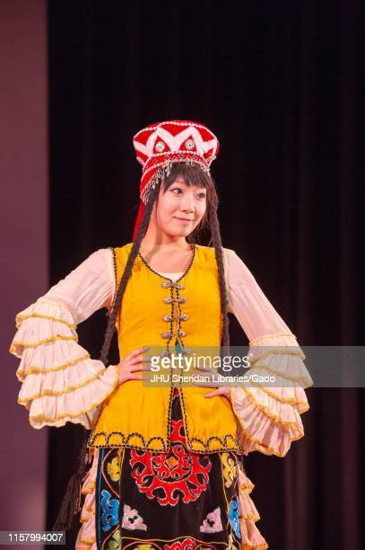 Three-quarter length shot of a costumed dancer from the Colorful China Dance Group, performing on stage during a Milton S Eisenhower Symposium at the...