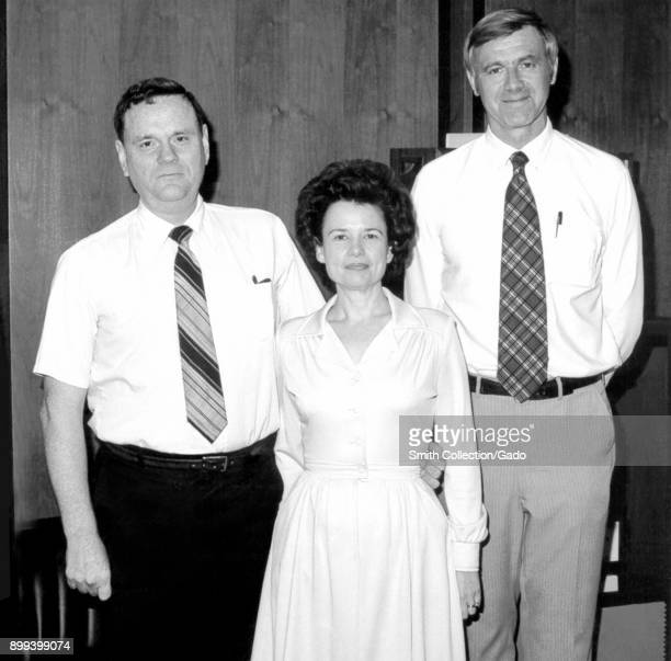 Threequarter length view of former Centers for Disease Control Director William H Foege MD MPH standing slightly behind Assistant Director of the CDC...