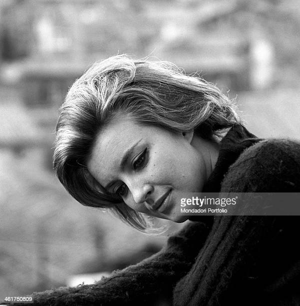Threequarter profile of the actress Ilaria Occhini who turns her face downwards covered with a sweater cinema actress for Vittorio De Seta in Half a...