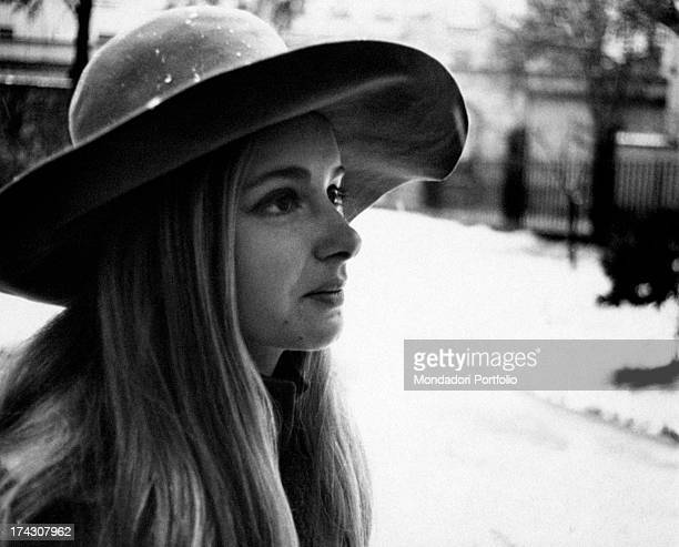 Threequarter profile of the Italian actress Valeria Ciangottini posing under the snow with a wide brim hat on her head the actress was discovered by...