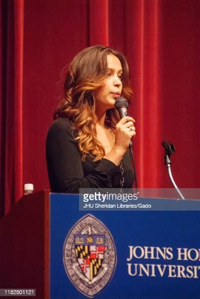 Threequarter profile view of model and philanthropist Petra Nemcova speaking from a podium during a Milton S Eisenhower Symposium Homewood Campus of...