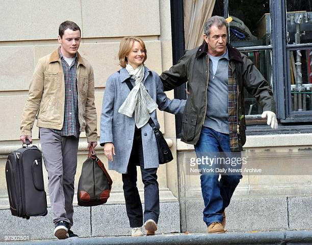 Three's a crowd Oscar winners Mel Gibson and Jodi Foster plus newcomer Anton Yelchin look both ways before crossing the Grand Concourse in the Bronx...