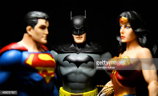threesome - wonder woman stock pictures, royalty-free photos & images