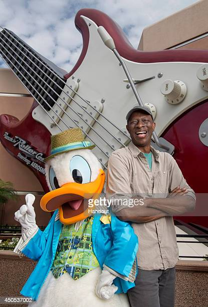 Threetime Grammy Award winner Keb' Mo' poses with Donald Duck in front of the giant guitar outside of the Rock 'n' Roller Coaster Starring Aerosmith...