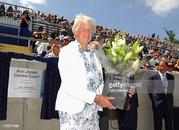 Threetime Grand Slam Champion Ann Jones receives a bunch of flowers during the Grand Opening of Centre Court after it was named in her honour during...