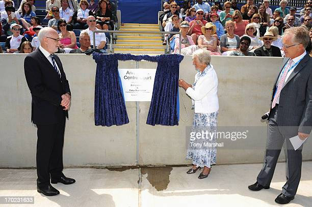 Threetime Grand Slam Champion Ann Jones unveils the newly named Ann Jones Centre Court with Peter Bretherton President of the LTA during the Grand...