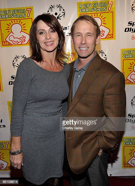 Three-time Olympic gold medalist Nadia Comaneci and husband Bart Conner attend a party celebrating the release of the 'A Very Special Christmas 7'...