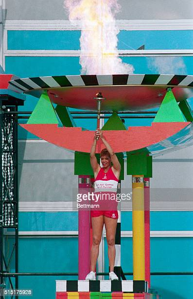 Three-time Olympic Gold Medalist Wilma Rudolph of the U.S. Lights the torch 8/8 in the opening ceremony of the pan American Games.