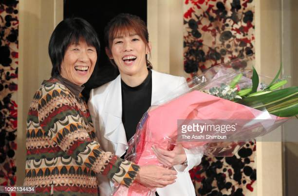 Three-time Olympic wrestling gold medalist Saori Yoshida and her mother Yukiyo pose for photographs during her retirement press conference on January...