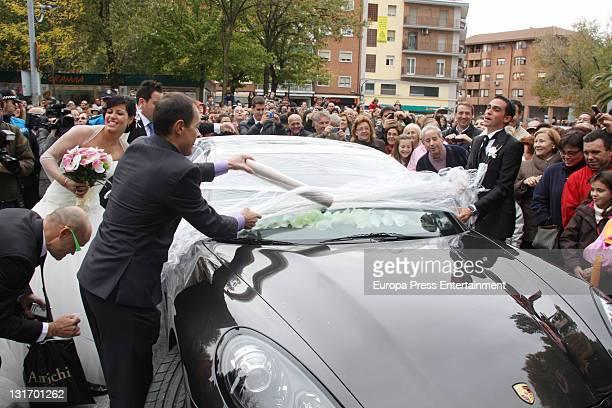 Threetime Tour de France champion Alberto Contador takes film off his car after his friends play a joke on him during his wedding at Santo Domingo de...