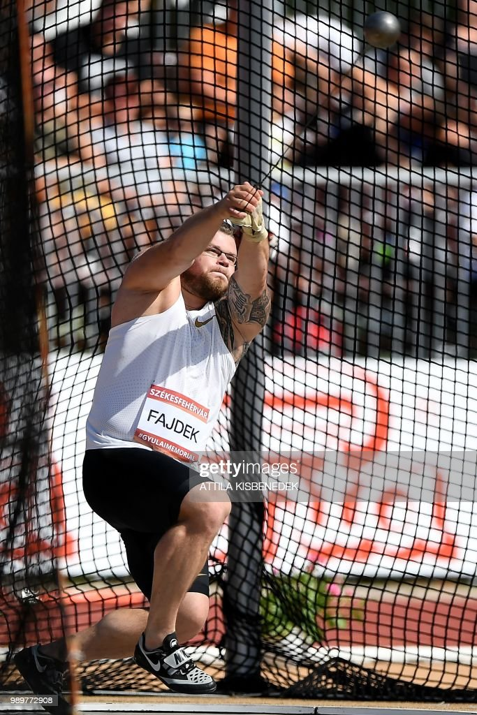 three time world champion poland s pawel fajdek competes during the