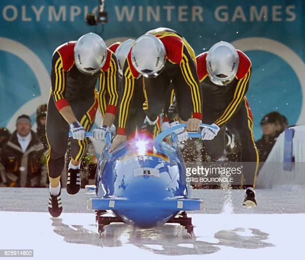 Threetime World championship medallist German bobsleigh pilot Andre Lange and his teammate Enrico Kuehn Kevin Kuske and Carsten Embach sprint as they...